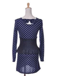 Blue in color, this long sleeve dress has polka dots throughout the