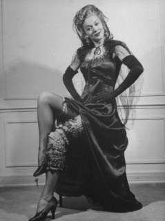 Actress Carole Landis Wearing Many Garters on Leg at Garter Party for