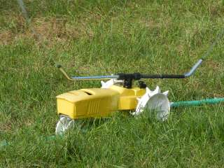 SEE VIDEO! NELSON RAINTRAIN TRAVELING LAWN TRACTOR SPRINKLER WALKING